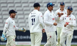 Essex's Alastair Cook celebrates catching out Somerset's Lewis Gregory.