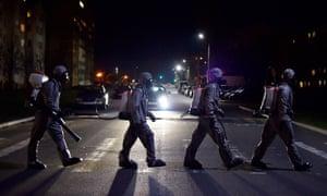 Belarusian servicemen cross a road after disinfecting a hospital in the town of Zaslauye, outside Minsk.