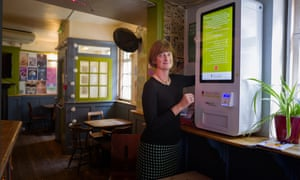 Gillian Dean, consultant HIV physician at Brighton and Sussex University hospitals NHS trust, with an HIV test vending machine.