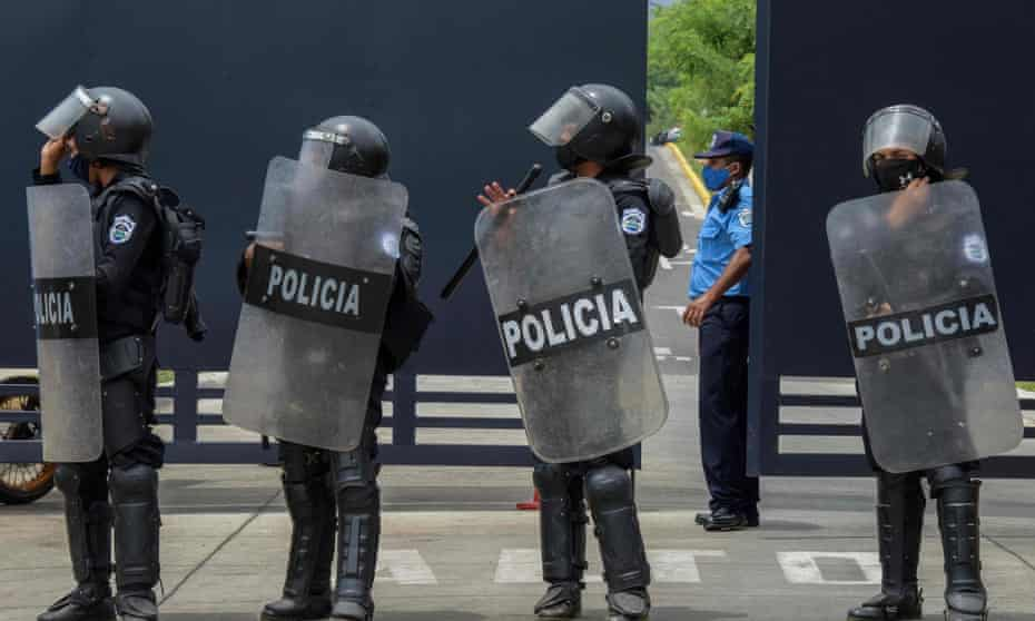 Riot police stand guard outside 'El Chipote', where Georgiana Aguirre-Sacasa believes her father is being detained.