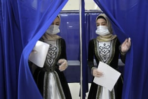 Grozny, RussiaChechen women in national costume leave a polling booth during the Parliamentary elections. Russia has begun the third day of voting for a new parliament.