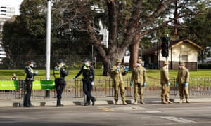Police and Australian Defence Force staff are seen in Melbourne.