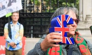Protester holding union flag pound sign