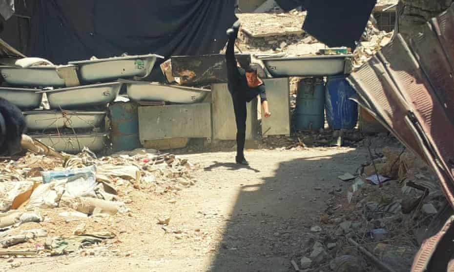 Ahmad Joudeh dances on rubble of his old refugee camp