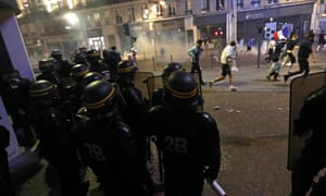 People run after police fired tear gas in downtown Lille.