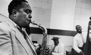 Charlie Parker, jazz musician, playing saxophone.