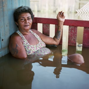 Francisca Chagas dos Santos in Taquari District, Rio Branco, Brazil in her flooded home