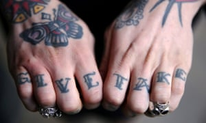 A tattoo enthusiast poses at the International London Tattoo Convention in London