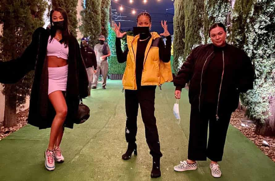 Rihanna, centre, wear Balenciaga 'five-finger' boots.