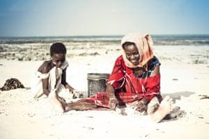 Collecting shells in Zanzibar, Tanzania