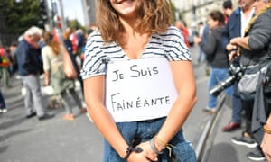 A demonstrator in Nantes holds a sign saying 'I am a slacker' during a protest called by several French unions against the labour law reform.
