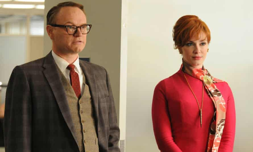 As Lane Pryce in Mad Men, with Christina Hendricks as Joan Holloway.