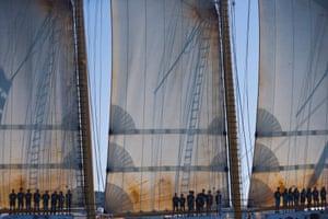 Human shadows cast on sails