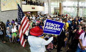 A supporter waits for the arrival of Democratic Georgia gubernatorial nominee Stacey Abrams during a rally in Morrow, Georgia, on 9 October.