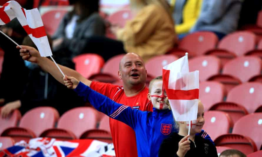 England fans wave flags in the stands during the friendly against Austria.