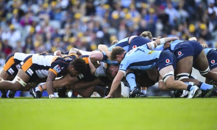 Waratahs and Brumbies players form a scrum
