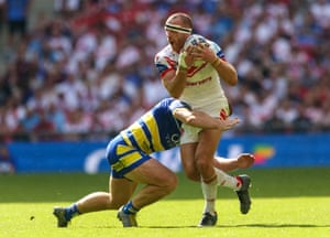 James Roby is tackled by Jack Hughes.