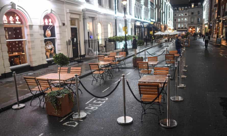 Empty tables outside restaurant