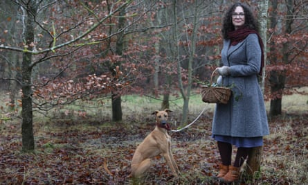 Emma Mitchell in the woods with her dog.