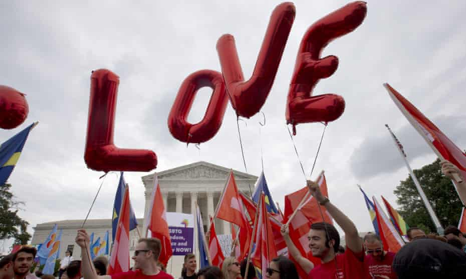"""Balloons spell out the word """"love"""" over the Supreme Court in Washington, Friday June 26, 2015, after the court declared that same-sex couples have a right to marry anywhere in the US. (AP Photo/Jacquelyn Martin)"""