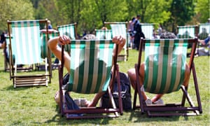 Two people sitting on deckchairs