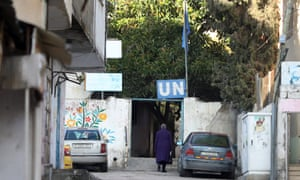 A woman arrives at a UN compound in the Balata refugee camp near the West Bank city of Nablus.