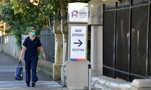 A worker arrives at the Hardi Aged Care nursing home at Summer Hill in Sydney