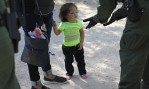 US border patrol agents take Central American asylum seekers into custody on 12 June near McAllen, Texas, and then sent to a processing center for possible separation.