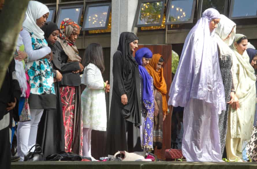Muslim women praying in Regents Park Mosque to celebrate the last day of the holy month of Ramadan.
