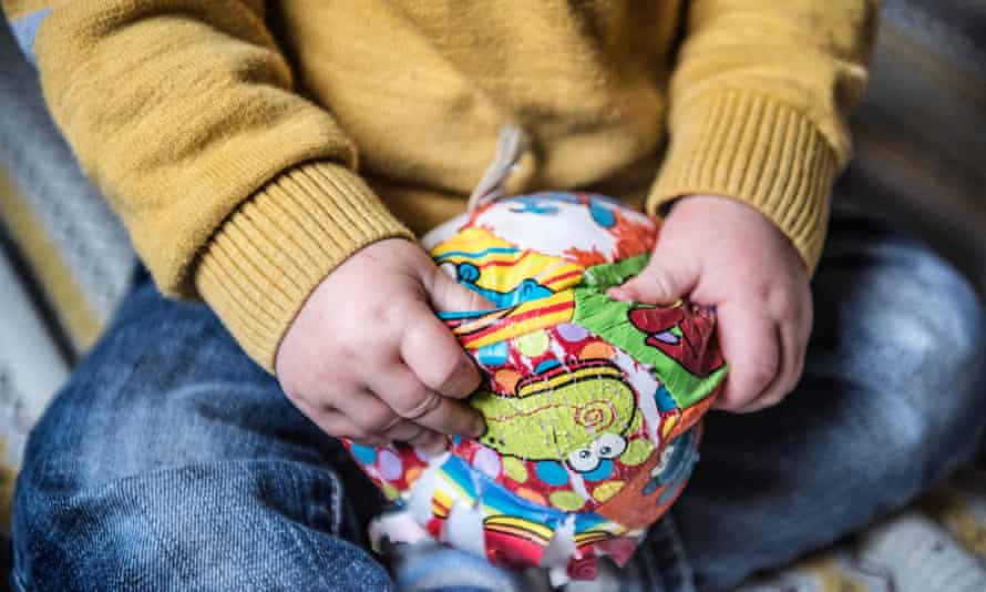 Child's hands with ball