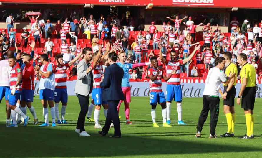 Granada players celebrate after beating Betis.