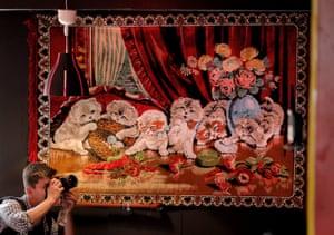Bucharest, Romania A photographer works inside the newly opened Bucharest Kitsch Museum