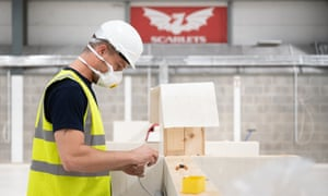 A worker helps to convert the indoor training centre at Parc y Scarlets rugby stadium in Llanelli, Carmarthenshire, into a field hospital for coronavirus patients.