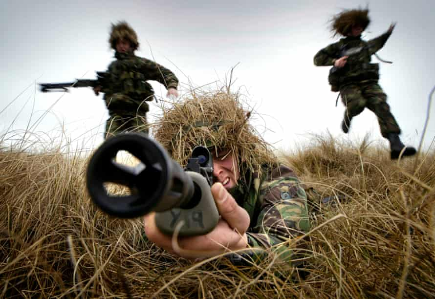 A marine from 45 Commando aims his rifle as he trains on the live firing range at Barry Buddon.