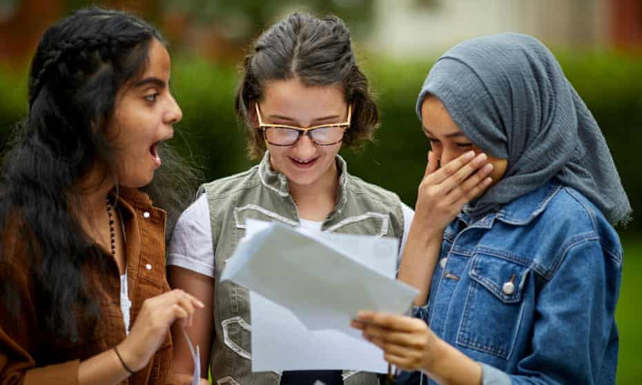 Friends at Whalley Range High School in Manchester getting their GCSE results in 2019.