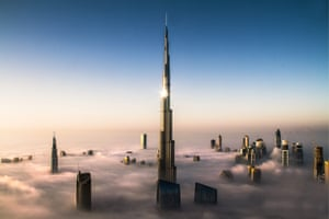 The world's tallest building, the Burj Khalifa, juts above the morning fog in Dubai. The fog is common at this time of year and is burned away as the sun rises. The tower stands at 828 metres (2,717ft).