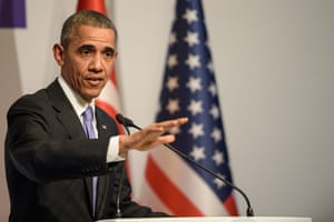 Barack Obama gestures during a press conference