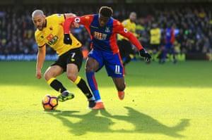Nordin Amrabat of Watford shields the ball from Crystal Palace's Wilfried Zaha