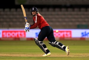 England's Sophie Ecclestone hits a boundary.