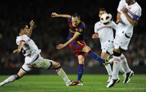 Andrés Iniesta manages to get a shot away despite being under pressure during Barcelona's 2-0 win over CA Osasuna in La Liga during April 2011.