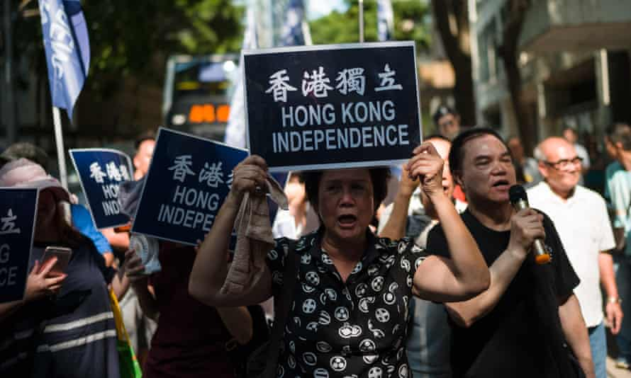 Pro-democracy activists march against a proposal to ban the pro-independence Hong Kong National Party in July