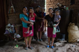 Juana Carranza, 31, holds her daughter Santos Griselda, 3; Silvia Pérez, 27, holds her son Elzer, 2; and María Elena Reyes, 36, holds her daughter Doren, 18 months.
