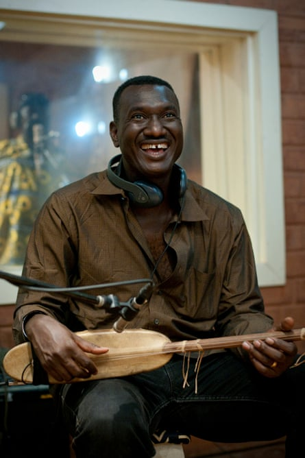 Bassekou Kouyate, one of the biggest names in west African music, plays the kora in a Bamako recording studio.