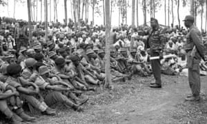 Amin addresses troops during a visit to border regions