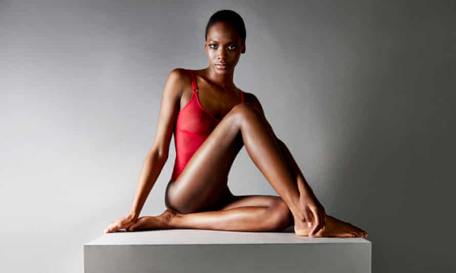 A model sitting on a plinth in a red 'body'