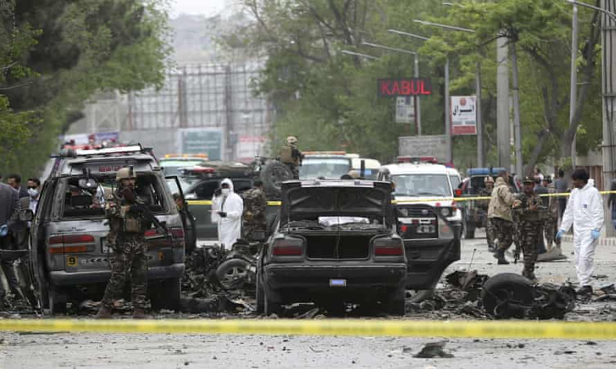 Security forces inspect the site of the suicide attack in Kabul on Wednesday.