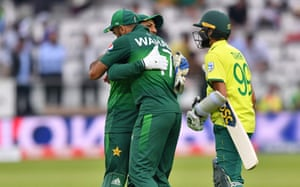 Pakistan's captain Sarfaraz Ahmed embraces teammate Wahab Riaz as he celebrates with his players after victory.