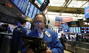 A trader works on the floor of the New York Stock Exchange on 26 December.