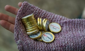 Representatives of Act Alliance hand out chocolate coins, promoting the need for climate finance for adaptation