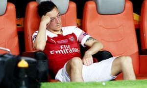 Arsenal's Mesut Özil cuts a dejected figure after being substituted during the Europa League final.